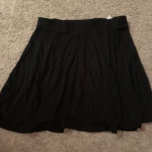 Black soft flowy skate skirt from garage
